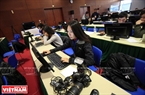 Channel News Asia's reporter Tan Qiu Yi works at the Press Centre. Photo: Trong Chinh