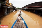 On December 14, Bach Dang street is flooded so the locals must use boats for transportation.