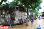 The popular wall in Hoi An is submerged.