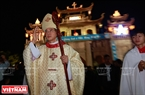 The priest for the Phat Diem parish, Giuse Nguyen Nang in charge of the Procession with Jesus.
