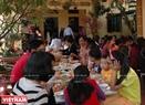 Vào dịp này, các gia đình ở Cổ Loa thường làm cỗ để con cháu về vui hội làng và sum họp đầu năm mới. Ảnh: Thanh Hòa/Báo ảnh Việt Nam