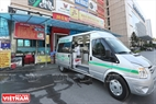 A food safety inspection vehicle parks beside a restaurant.