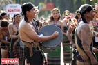 Sounds of gongs contribute to creating the exciting atmosphere of the festival.