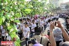 Volunteers carry branches of coffee to show the local desire for sustainable development.