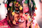 A cute foreign child with colours on face. Photo: Tran Hieu/VNP