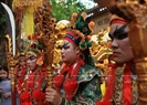 Buddhist followers disguise themselves as Tuong characters to participate into the procession.