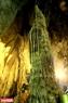 Một khối thạch nhũ cao sừng sững giữa động, được người xưa đặt tên là cây Bạc. Ảnh: Trần Hiếu