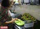 Lieu prepares the bananas before taking them to the park.