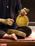 The combination between drum and clappers in the traditional art of Xam singing.