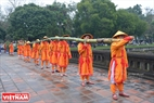 10 men acting as soldiers carrying the long bamboo pole. Photo: Thanh Hoa