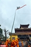 The tall pole with a red band flying in front of Hien Lam Cac. Photo: Thanh Hoa