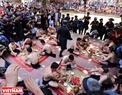 The Vat cau bun festival starts with a ceremonial feast for the players who are offered Van village's well-known rice liquor.
