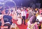 """Các cặp đôi được tổ chức đám cưới là những người khuyết tật có hoàn cảnh khó khăn và đều chưa một lần được """"lên xe hoa""""."""