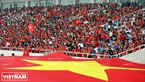A large national flag is spread at My Dinh National Stadium to welcome the returning athletes.