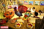 The kids are taught by artisans how to make paper masks and other traditional toys.