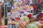 Offerings consist of a pig, a boiled chicken, sticky rice, liquor, fruit and votive paper.